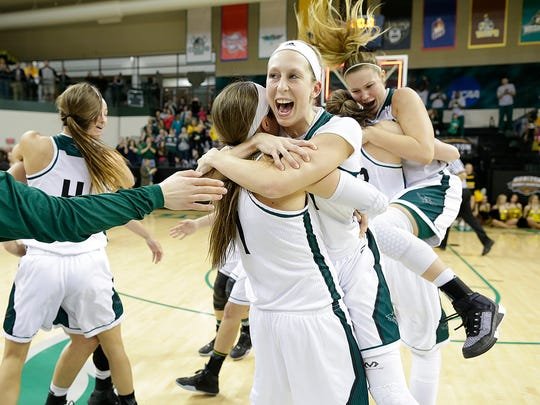 UW-Green Bay's Allie LeClaire leaps into the arms of