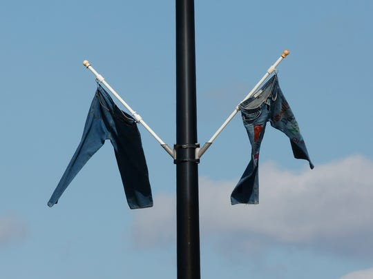 Jeans hang from poles on West Johnson Street Tuesday April 12.