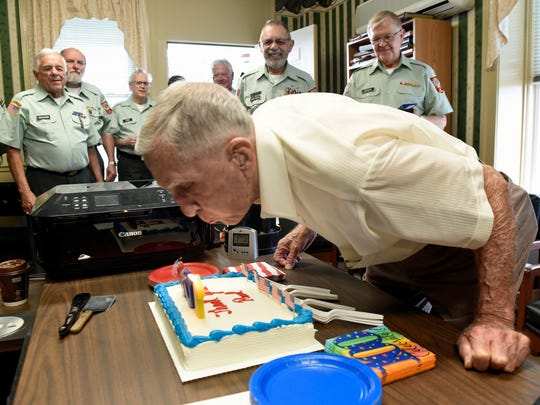 Paul Kriner blows out candles on his birthday cake.