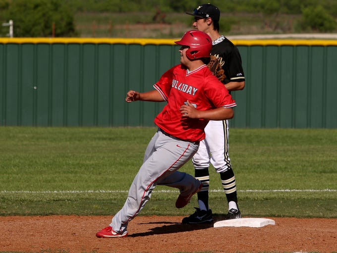 Holliday's Jake Turner looks for the ball while rounding