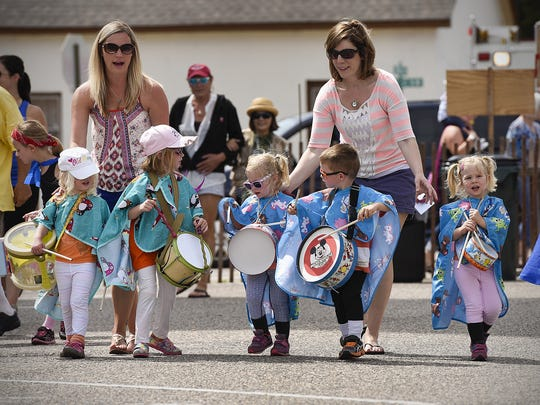 The children's parade weaved its way through the church