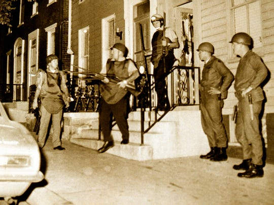 Police seize weapons from a home on North Newberry Street in York during the riots of 1969.