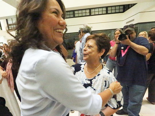 El Paso County Judge Veronica Escobar, foreground,