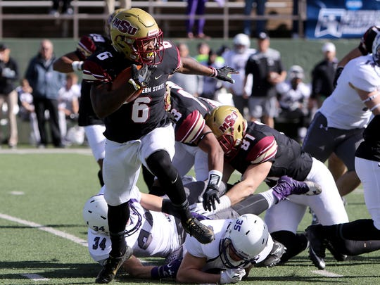 Midwestern State's Brandon Sampson looks upfield as he runs toward the sideline in a playoff game against Sioux Falls Saturday, Nov. 18, 2017, at Memorial Stadium. The Mustangs defeated the Cougars 24-20 in the first round of the NCAA DII Playoffs.