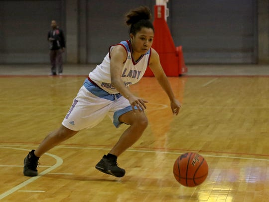 Hirschi's Jania Vinson goes for the loose ball in the game against Rider Saturday, Dec. 2, 2017, at Kay Yeager Coliseum.