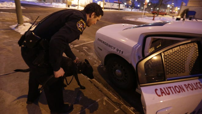 Officer Lucas Meyer goes on patrol Sunday in Kaukauna with Rocko.