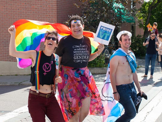 Pride Center Safe Space Coordinator Julia Berberan, Transgender Progam Coordinator Gustavo Mercado Muñiz, and Director of Safe Space Skylar Wolfe radiate positive energy as they make their way to Church Street.