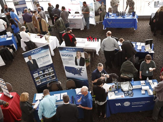 Visitors to the Pittsburgh veterans job fair meet with recruiters in March at Heinz Field in Pittsburgh.