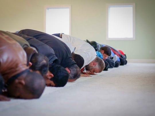 Members of the Muslim faith pray at the new Tri-State