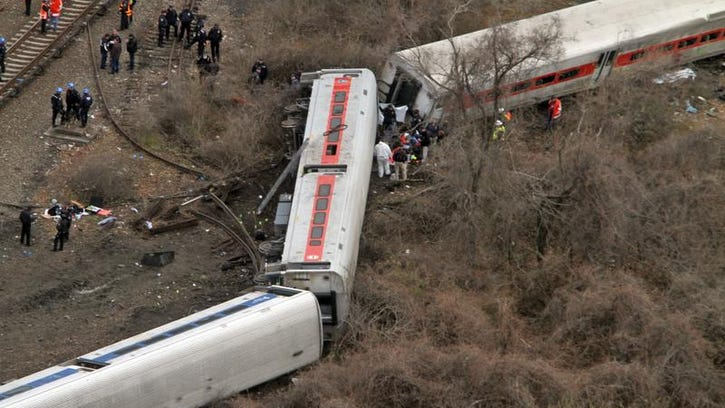 Emergency personnel work at the scene of a Metro-North train that derailed just north of the Spuyten Duyvil station in the Bronx on Dec. 1. A lawyer for one of the victims said the rail company broke a promise to pay medical bills for the injured.