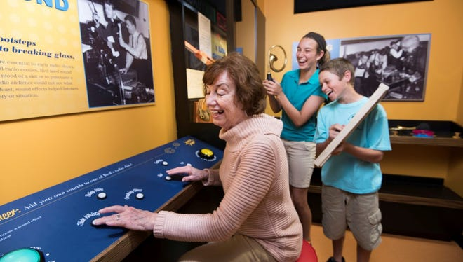 Visitors enjoying one of the many interactive exhibits in the Red Skelton Museum.