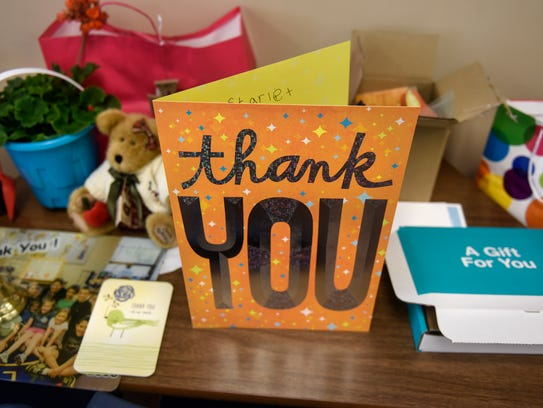 Gifts and cards are collected on a table of the classroom