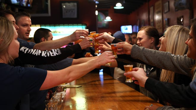 Russian River Brewing Co. staff members toast.