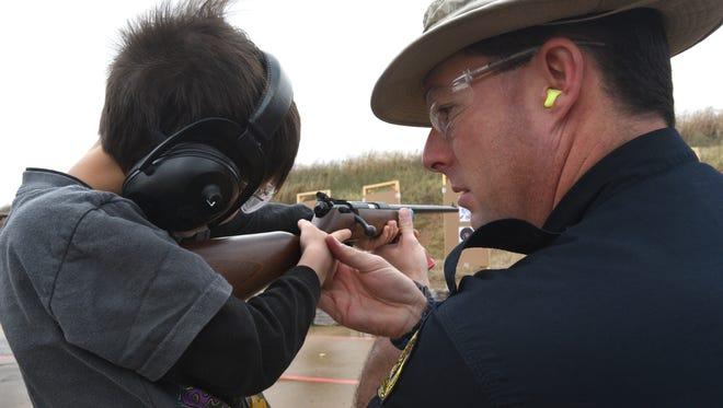 Corporal Frank Edmonson instructs Remington Joe at the Sheriff's Regional Law Enforcement Training Academy's First Gun Course.