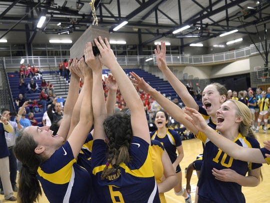 Pittsford Sutherland celebrates with the championship trophy during the Section V Class A final at Gates Chili High School on Friday, Nov. 4, 2016. No. 2 seed Pittsford Sutherland beat No. 1 seed Irondequoit 3-1 (20-25, 25-22, 26-24, 28-26).