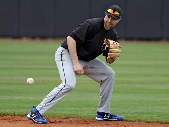 Neil Walker fields a ground ball during infield drills before a scrimmage game in Bradenton, Fla. on Feb. 27, 2018.