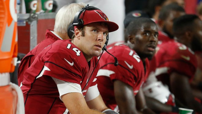 Arizona Cardinals QB Ryan Lindley sits on the bench after throwing an interception to the Seattle Seahawks during the first quarter in NFL action at University of Phoenix Stadium in Glendale, Ariz. December 21, 2014.