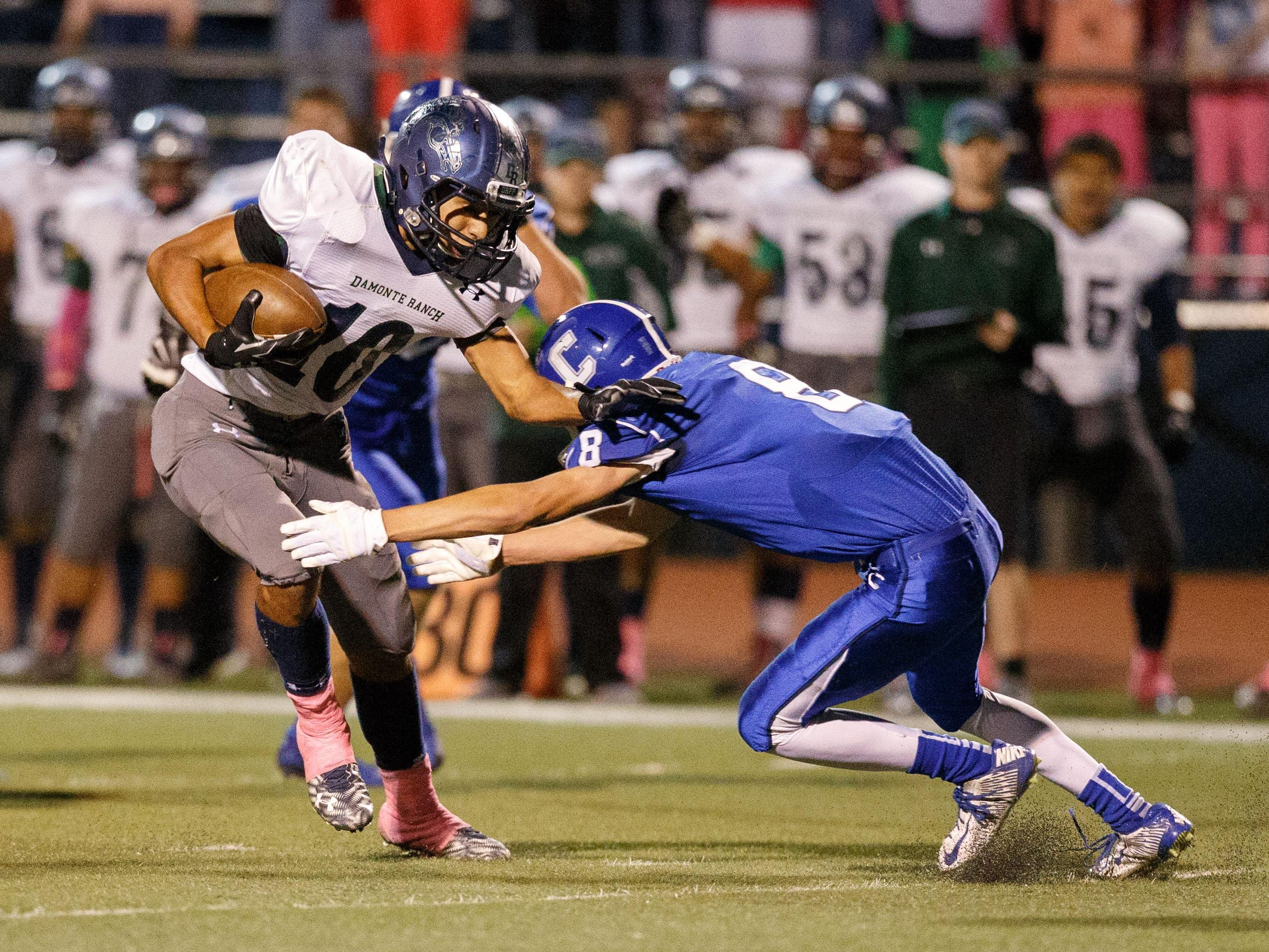 Damonte Ranch's Robert Garlock runs against Carson's Connor Pradere during Friday's game in Carson City.