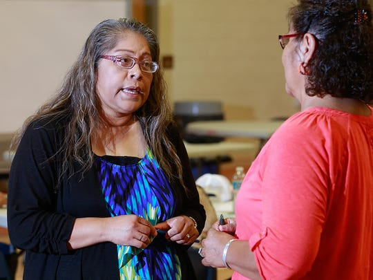"""Larieta Tso of the Office of the Navajo Tax Commission attends a meeting on Friday at the Shiprock Youth Complex where officials explained how revenue from the tribe's """"junk food"""" tax can be used."""