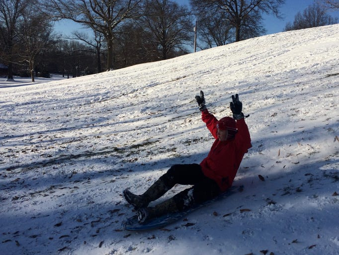 Gabe Graham, 14, of Waynesboro, sleds down the hill