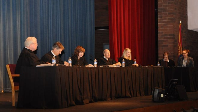 The Arizona Supreme Court Justices (from left) Robert Brutinel, Justice; Scott Bales, Vice Chief Justice; Rebecca White Berch, Chief Justice; John Pelander, Justice, and Ann Timmer, Justice. In distance, Bailiff Karen Gehres and Clerk of the Court Tisha Lavy. The state high court conducted a session at Mountain Pointe High School's auditorium in Ahwatukee on Dec. 10.