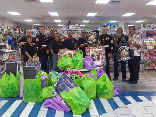 Toys for Tots donation: The Veterans of Guam Motorcycle