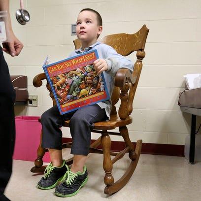 Arthur Murray, 8, talks to Nurse Barb Demasi at Taylor