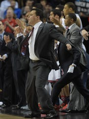 Arizona Wildcats head coach Sean Miller reacts against the Ohio State Buckeyes during the second half in the third round of the 2015 NCAA Tournament at Moda Center.