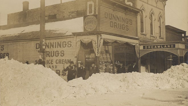 This image shows the second location of Dreamland theater in the winter of 1909 after a huge snow storm. The view here is looking northwest from 8th Street and Phillips Avenue.