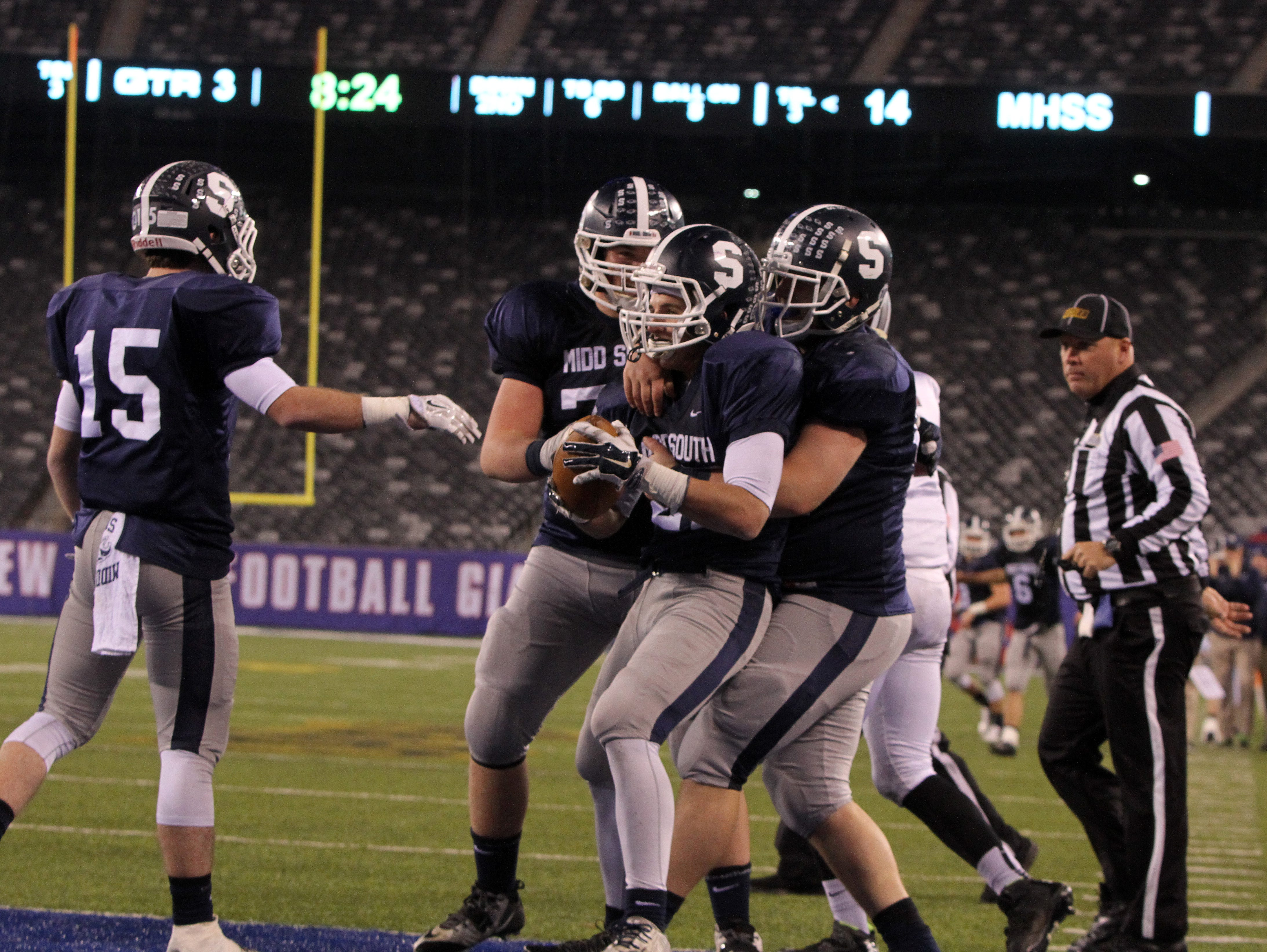 Middletown South's #27 Cole Rogers celebreates a touchdown in the 3rd quarter against Phillipsburg High School during the North 2 Group IV game of the 2015 NJSIAA/MetLife Stadium High School Football Championships at MetLife Stadium in East Rutherford, NJ Saturday December 5, 2015.