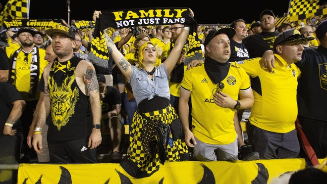 Columbus fans cheer after a Crew game at Mapfre Stadium last August. Under Gov. Mike DeWine's new order on limited number of fans being allowed at sporting events, the Crew would have just 1,500 fans at games.