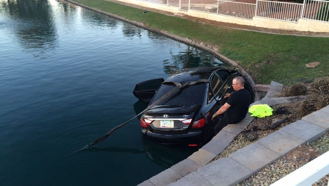 Peoria dive teams went into a lake near 107th Avenue and Beardsley Road on Feb. 5, 2015. No one was inside the car.
