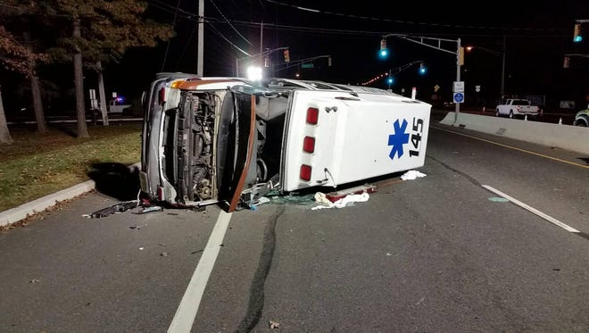 Hours after the crash, the Quality Medical Transport ambulance remained where it had come to rest after it collided with a pick-up truck in Manchester Township on Saturday afternoon.