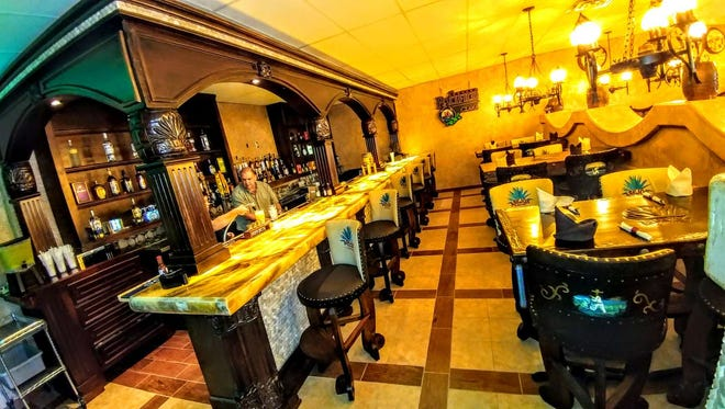 A full bar with dining area in the newly expanded Anejos Restaurant in Waite Park.