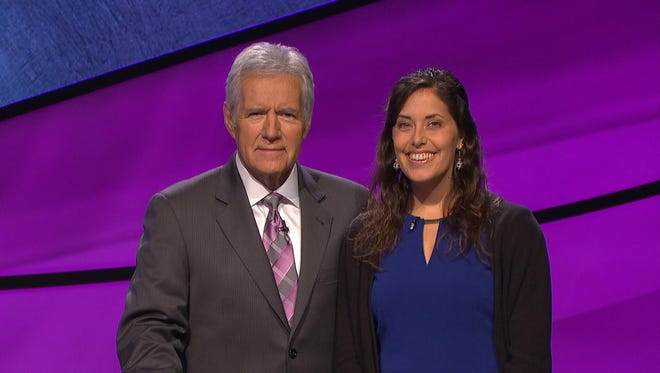 """Kristin Szuhany, right, is seen here with """"Jeopardy"""" host Alex Trebek during her appearance on the long-running quiz show."""