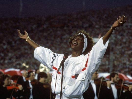 Whitney Houston sings the National Anthem before  Super Bowl XXV at Tampa Stadium on January 27, 1991 in Tampa, Florida.