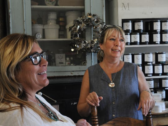 Mary Livingston, left, owner of Lavender Blue, and manager Kathrina Smith are inside a warehouse where the business relocated. The store was in downtown Ventura for 20 years but with slowing retail sales in part due to more online shopping businesses are changing their business model.