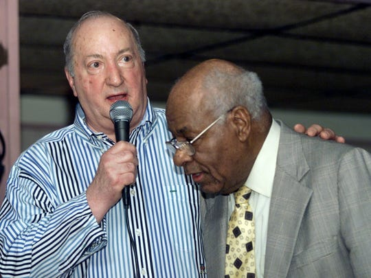 Joe Cavallaro, left, honors Elmira jazz promoter Howard Coleman in 2004 during Cavallaro's annual anniversary party at Lib's Supper Club in Elmira.