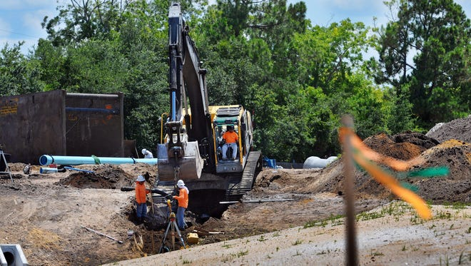 Crews work on the Cape Canaveral National Cemetery on Highway 1 in Mims. Construction crews under the supervision of  G&C Fab-Con,LLC work on the new 318-acre Cape Canaveral National Cemetery on Highway 1 in Mims, and will serve the burial needs of more then 163,000 veterans .