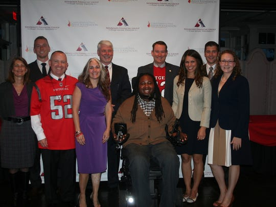 Newroads Financial Group team poses with Eric LeGrand.
