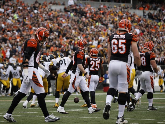 Dalton (center) leaves the field with an injured right thumb.