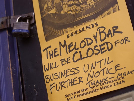 A sign hangs on the padlocked front door of the Melody Bar on Thursday March 22, 2001.