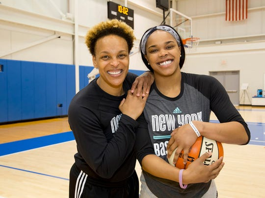 Former New York Liberty All-Star Teresa Weatherspoon (left) and current Liberty guard Brittany Boyd (right) pose at the team's annual summer basketball camp in Tarrytown. July 28, 2016.
