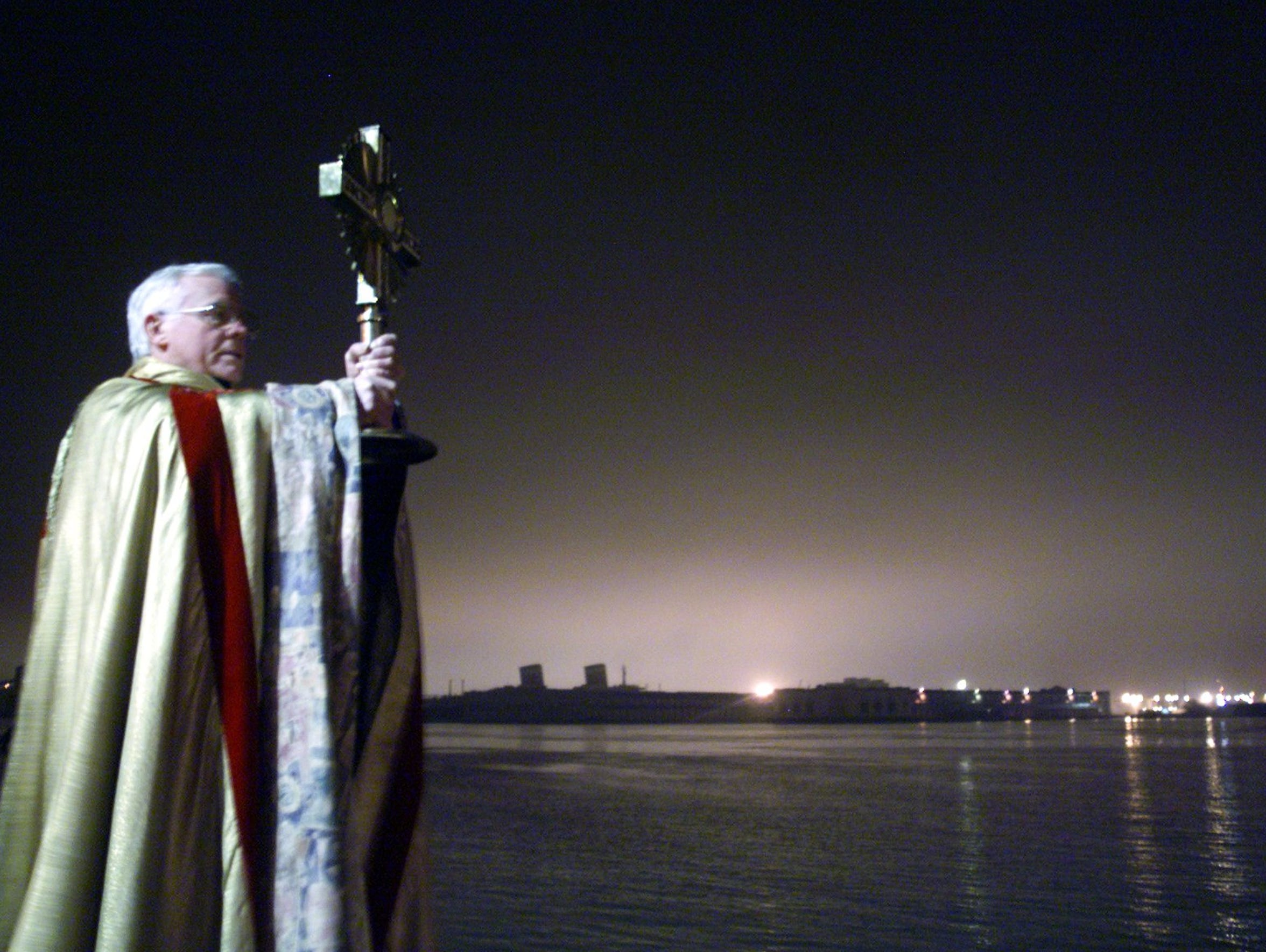 Monsignor Michael Doyle blesses the Delaware River