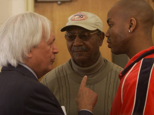 Joe Taub, Larry Doby and Stephon Marbury talk during half time of the all star game at Martin Luther King Grammar School in Paterson, April 13, 2000.