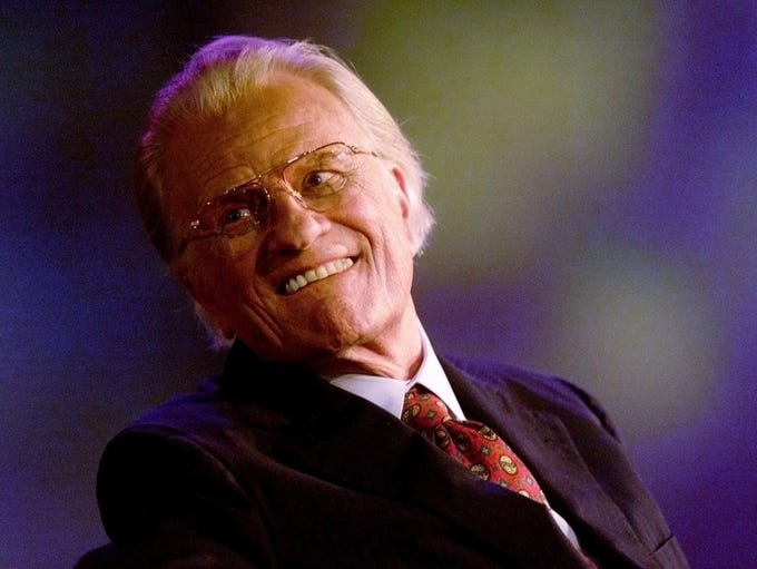 The Rev. Billy Graham wears a smile just before speaking