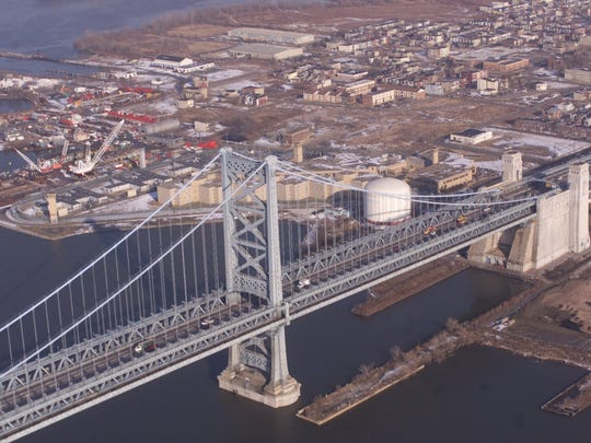 The stone anchorage (right) of the Ben Franklin Bridge on the Camden side is one of two that help hold up the suspension bridge between Camden and Philadelphia.