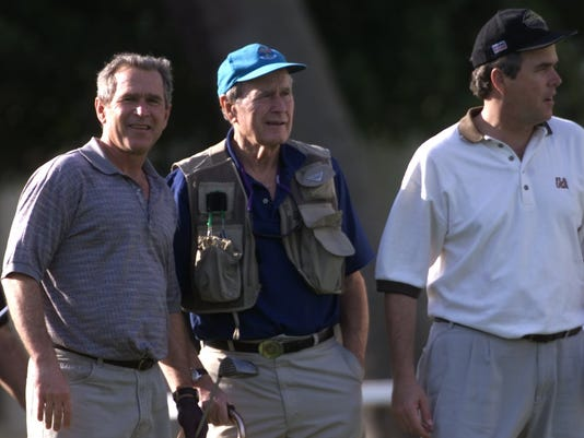 GEORGE W., GEORGE SR., AND JEB BUSH PLAY GOLF AT GASPARILLA INN