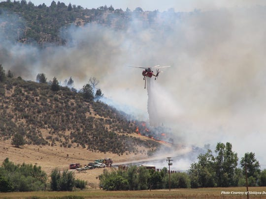 Crews drop water on a section of the Klamathon Fire