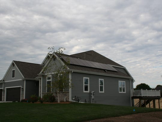 Solar panels on the side of the homes are meant to